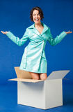 Woman out of the box Stock Photos
