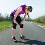 Woman out of breath . Tired young woman is out of breath after sport workout stock photography