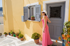 Woman out of the doors   beautiful house Royalty Free Stock Photography