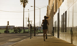 Woman out for a morning run Royalty Free Stock Image