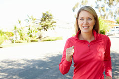 Woman out for a run Stock Image