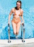 Woman at swimming pool Royalty Free Stock Photos