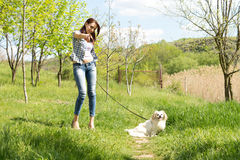 Woman out walking her dog and pointing Royalty Free Stock Images