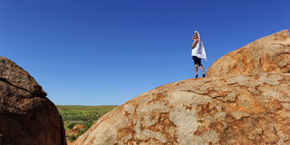 Woman on Outback Rock Royalty Free Stock Photo