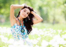 Woman outdoor. Beautiful young brunette woman outdoor on a summer day royalty free stock photos