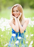 Woman outdoor. Happy young blond woman outdoor on a summer day stock images