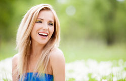 Woman outdoor. Happy young blond woman outdoor on a summer day royalty free stock image