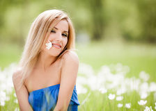 Woman outdoor. Happy young blond woman outdoor on a summer day stock image