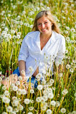 Woman outdoor with dandelion Royalty Free Stock Photo