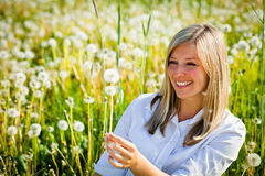 Woman outdoor with dandelion Stock Image
