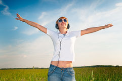 Woman outdoor listening to music Royalty Free Stock Images