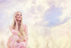 Woman Outdoor Portrait, Happy Girl Fashion Model on Sky. Woman Outdoor Portrait, Happy Girl over Sky Clouds, Smiling Fashion Model in Pink Dress stock images
