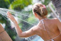 Woman in outdoor shower Stock Photos