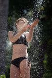 Woman in the outdoor shower. Girl in the outdoor shower Stock Photo