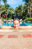 Woman in outdoor swimming pool Royalty Free Stock Photos