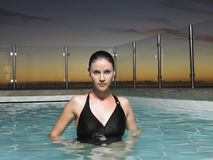 Woman In Outdoor Swimming Pool Stock Images