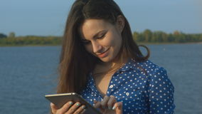 Woman outdoor using digital tablet stock video footage