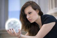 Woman outdoors. Girl with globe in hands Stock Photography