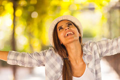 Woman outdoors arms outstretched Royalty Free Stock Photography