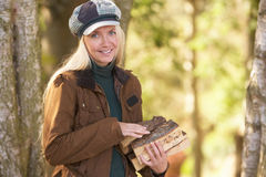 Woman Outdoors In Autumn Woodland Gathering Logs Royalty Free Stock Photography
