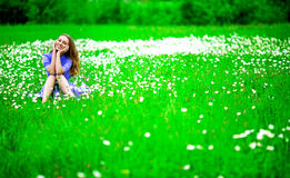Woman outdoors. Beautiful young woman outdoors, on the meadow with white flowers Stock Image