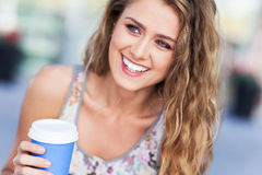 Woman outdoors with coffee Stock Images