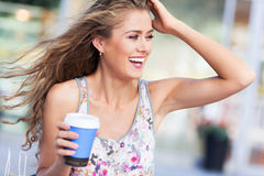 Woman outdoors with coffee Royalty Free Stock Images