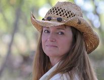 A Woman Outdoors in a Cowboy Hat Stock Photo