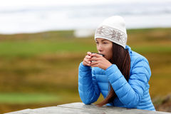 Woman in outdoors drinking coffee from cup Stock Photo