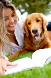 Woman outdoors with her dog Royalty Free Stock Photography