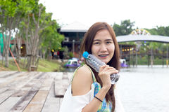 Woman outdoors holding a bottle of water Stock Photography