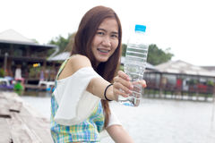 Woman outdoors holding a bottle of water Stock Images