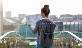 Woman outdoors holding map Stock Photos