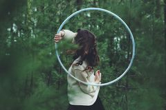 Woman outdoors with hula hoop Royalty Free Stock Images