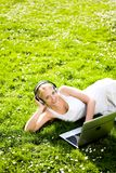 Woman outdoors with laptop Stock Image