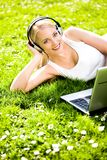 Woman outdoors with laptop Stock Images