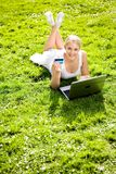 Woman outdoors with laptop Royalty Free Stock Photo