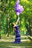Woman outdoors in the park Stock Photos