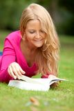 Woman outdoors reading Stock Photos