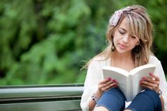 Woman outdoors reading Stock Photography