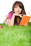 Woman outdoors reading book Stock Image