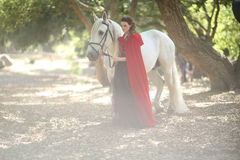 Woman Outdoors With a White Horse Royalty Free Stock Photo