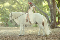 Woman Outdoors With a White Horse Stock Image