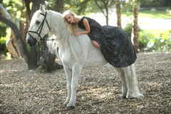 Woman Outdoors With a White Horse Stock Images