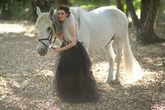 Woman Outdoors With a White Horse Royalty Free Stock Image
