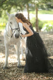Woman Outdoors With a White Horse Stock Photos
