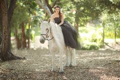 Woman Outdoors With a White Horse Royalty Free Stock Images