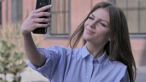 Woman Outside Office Taking Selfie on Smartphone royalty free stock photography