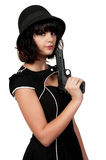 Woman Outlaw. Beautiful young woman criminal with a gun Stock Image