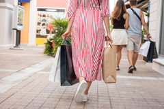Woman outlet shopping concept. Woman with bags in outlet shopping and sale concept Royalty Free Stock Photo